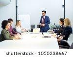 businessman giving a... | Shutterstock . vector #1050238667