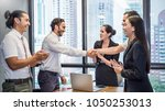 group of multicultural young... | Shutterstock . vector #1050253013