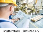 side view of two workmen... | Shutterstock . vector #1050266177