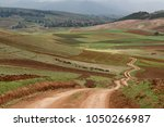 zig zag road pass trough... | Shutterstock . vector #1050266987