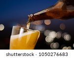 motion of beer pouring from... | Shutterstock . vector #1050276683