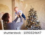 the father playing with his son | Shutterstock . vector #1050324647