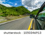 a car driving on a motorway at ...   Shutterstock . vector #1050346913