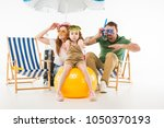 family in swimming goggles... | Shutterstock . vector #1050370193