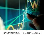 a stock trader checking... | Shutterstock . vector #1050436517