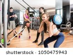 young determined fit woman... | Shutterstock . vector #1050475943
