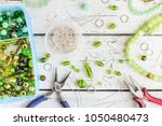 work table with beads and...   Shutterstock . vector #1050480473