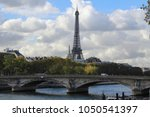 Small photo of Paris France in October of 2017: The best thing about the world famous Eiffel Tower is it is visible from so many different places in Paris. Turning a corner and all of a sudden having this as a view.