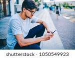 casual dressed hipster guy in... | Shutterstock . vector #1050549923