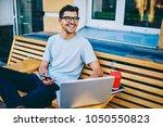 happy young man in eye glasses... | Shutterstock . vector #1050550823