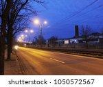 evening street with lanterns | Shutterstock . vector #1050572567