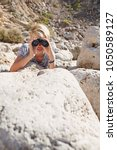 teenager male in textured rocky ... | Shutterstock . vector #1050589127
