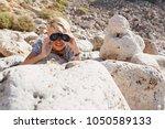 teenager male in rocky terrain... | Shutterstock . vector #1050589133