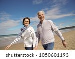 senior couple walking at the... | Shutterstock . vector #1050601193