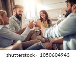 happy friends drinking wine and ... | Shutterstock . vector #1050604943
