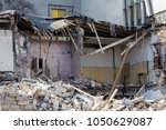 an abandoned house collapses in ... | Shutterstock . vector #1050629087
