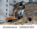 an abandoned house collapses in ... | Shutterstock . vector #1050629183