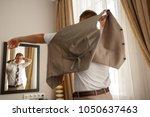 businessman preparing to work ...   Shutterstock . vector #1050637463