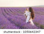 happy mother with pretty... | Shutterstock . vector #1050642347