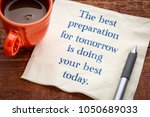 Small photo of The best preparation for tomorrow is your best today - handwriting on napkin with a cup of coffee