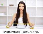 eating disorder. girl is...   Shutterstock . vector #1050714707
