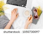 young woman freelancer working... | Shutterstock . vector #1050730097