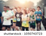 blurred group of runner are... | Shutterstock . vector #1050743723