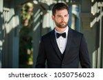 handsome male model in clean... | Shutterstock . vector #1050756023