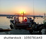 a fishing boat waiting for the...   Shutterstock . vector #1050781643