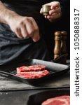 chef sprinkle salt beef steaks... | Shutterstock . vector #1050888317