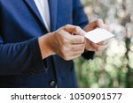 man holding white business card ... | Shutterstock . vector #1050901577