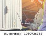 engineer and technician... | Shutterstock . vector #1050936353