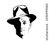 silhouette of man in a hat and... | Shutterstock .eps vector #1050999083
