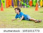 kid boy having fun to play... | Shutterstock . vector #1051011773