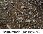 wet soil background. wet ground ... | Shutterstock . vector #1051099643