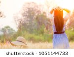 woman spending summer holiday... | Shutterstock . vector #1051144733