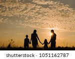 family on sunset background.... | Shutterstock . vector #1051162787