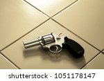 revolver gun  laying on room... | Shutterstock . vector #1051178147