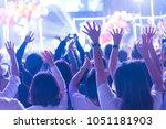 crowd of hands up concert stage ... | Shutterstock . vector #1051181903