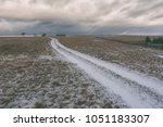 road to the horizon in the snow | Shutterstock . vector #1051183307