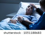 daughter supporting sad  dying... | Shutterstock . vector #1051188683