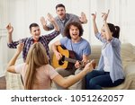 a group of friends with a... | Shutterstock . vector #1051262057