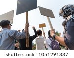 men and women share a protest... | Shutterstock . vector #1051291337