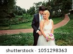 bride and groom at wedding day... | Shutterstock . vector #1051298363