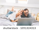 young couple watching a movie... | Shutterstock . vector #1051324313