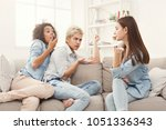 female friends chatting at home.... | Shutterstock . vector #1051336343