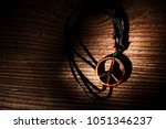 necklace with wooden peace... | Shutterstock . vector #1051346237