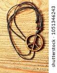 wooden peace symbol on wooden... | Shutterstock . vector #1051346243