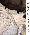 ladder to ancient cliff... | Shutterstock . vector #1051364027