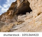 ancient cliff dwelling ruins at ... | Shutterstock . vector #1051364423